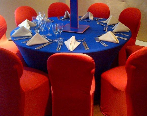 red contour chair covers with blue spandex table cloth