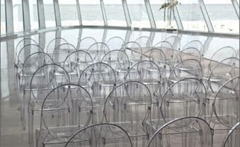 lucite chairs set up for an art event