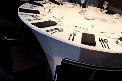 white spandex dinner tables