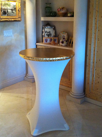 gold spandex table topper over white spandex