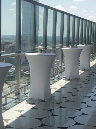 tall cocktail tables with white spandex linens