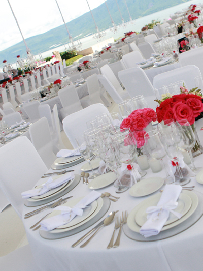 White spandex chair covers used for an outdoor wedding