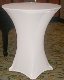 highboy with white spandex linens